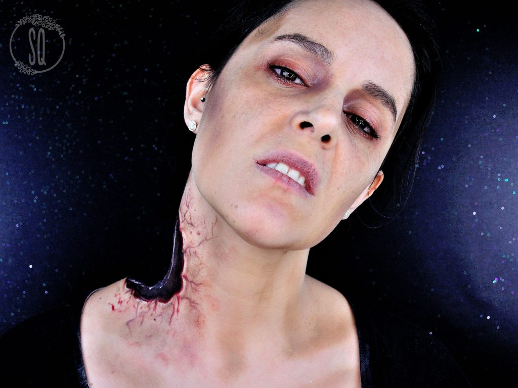 Zombie with part of neck off from a bite makeup tutorial
